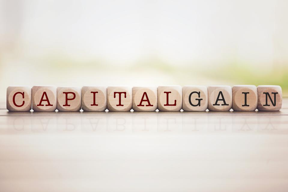 Capital Gain written on cube wooden blocks.