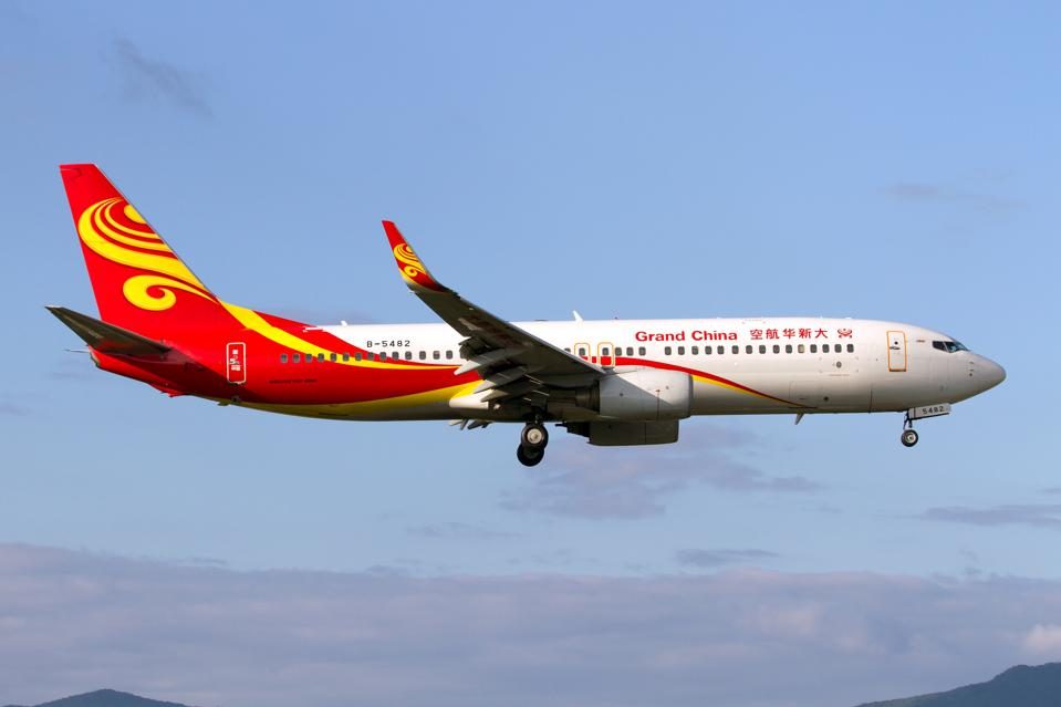 Grand China Air Boeing 737-800 landing at Sanya Phoenix...