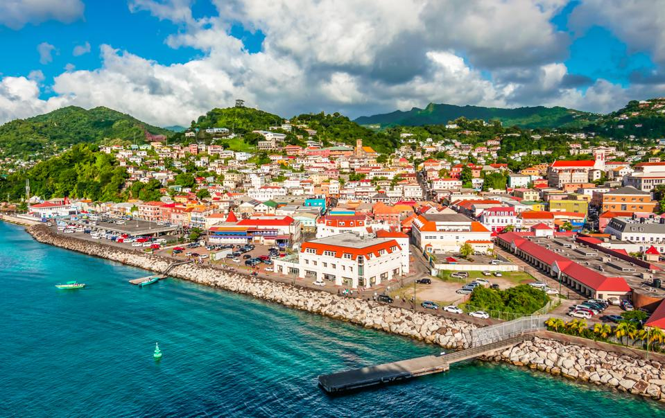 St George's, Grenada - picture of the city with the port. Beautiful red roofs on buildings