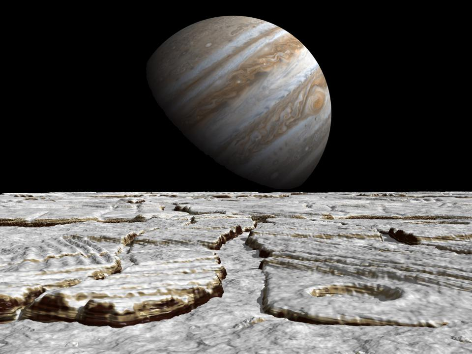 Artist's concept of Jupiter as seen across the icy surface of its moon Europa.