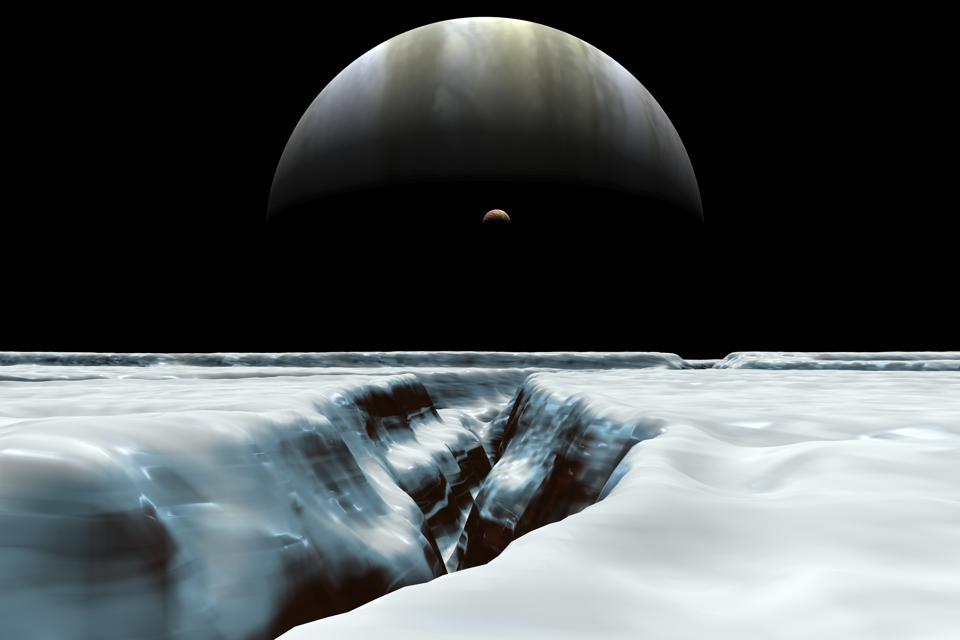 A crescent Jupiter and volcanic satellite, Io, hover over the horizon of the icy moon of Europa.