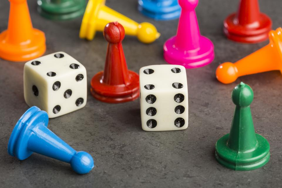 Game pieces with dices on slate