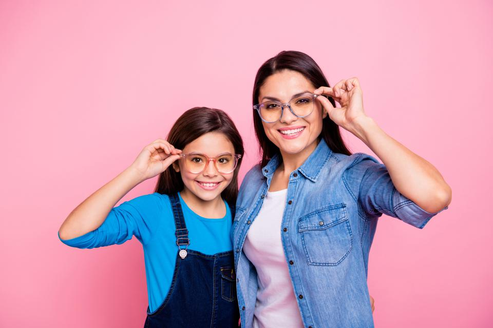 Baby Health in Winter Portrait of two nice trendy cute winsome pretty lovely attractive charming cheerful cheery positive straight-haired girls touching glasses lifestyle isolated over pink pastel background