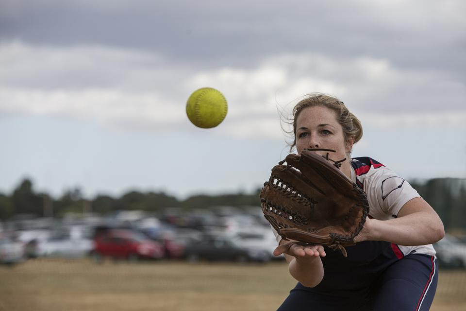 Female softball player catching the ball