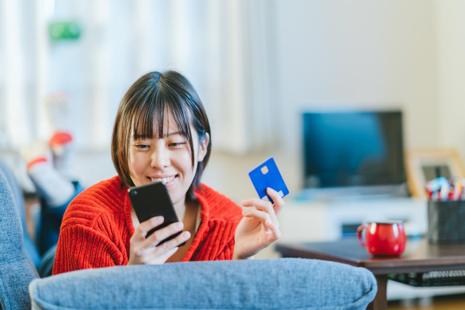 Young woman shopping online at home