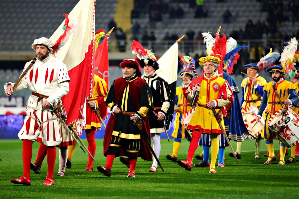 A parade of medieval dressed teams at the Calcio Storico competition in Italy
