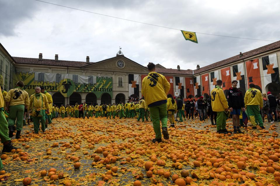 A battle with oranges at Italian Carnival Of Ivrea