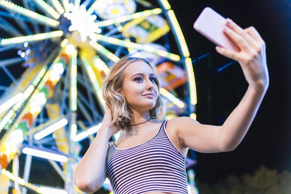 A girl who takes selfie.