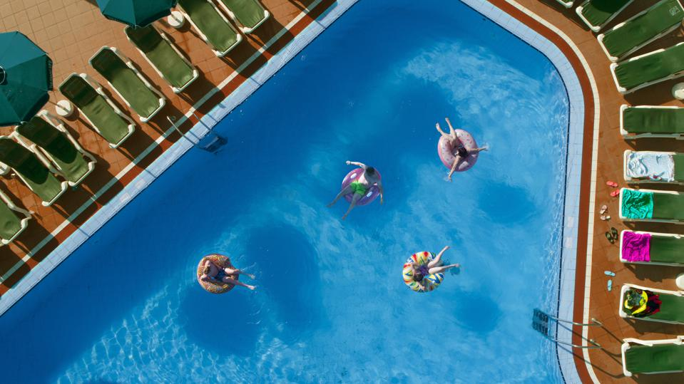 Family in swimming pool on holiday