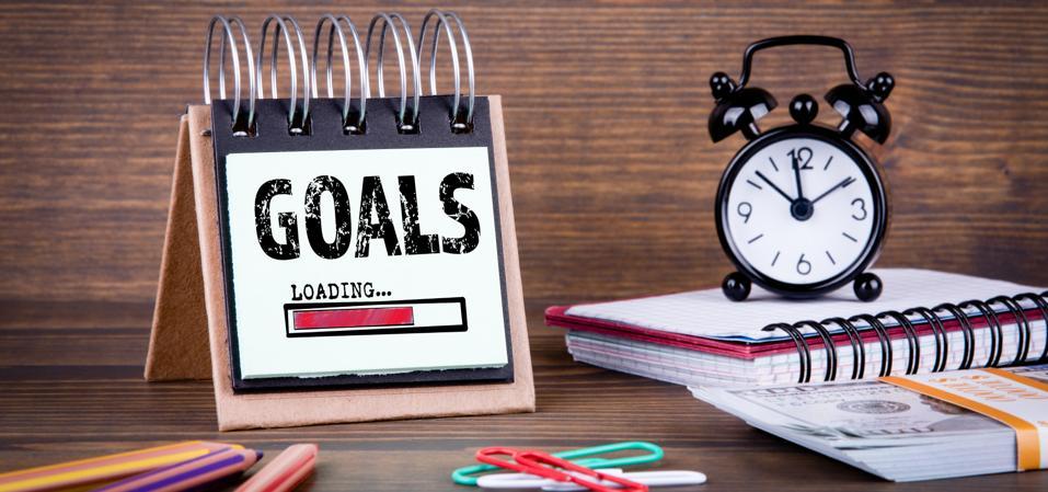 Goals ″loading,″ clock, notebook, cash: decision-making.