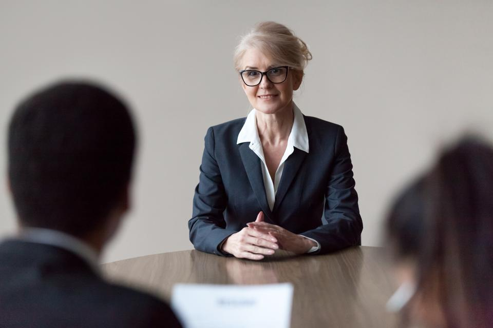 Middle-aged female professional at a job interview -- you can have a successful job search over 50