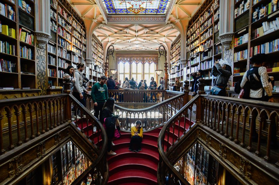 Visitors are seen in the famous Lello Library. Livraria ...