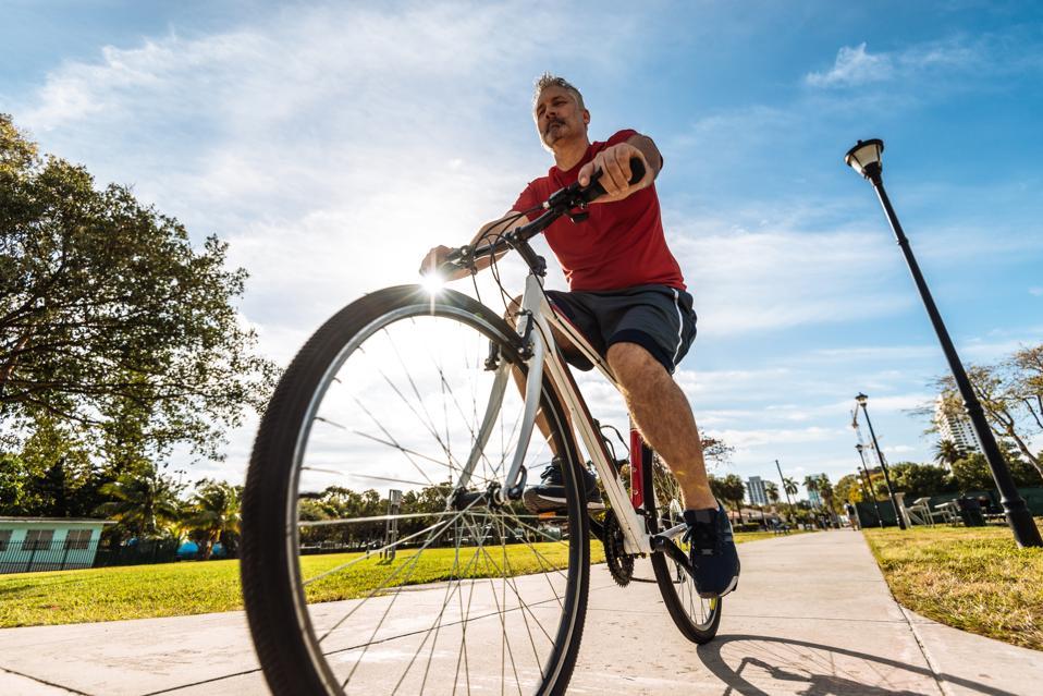 Mature caucasian man riding bicycle in Miami, USA