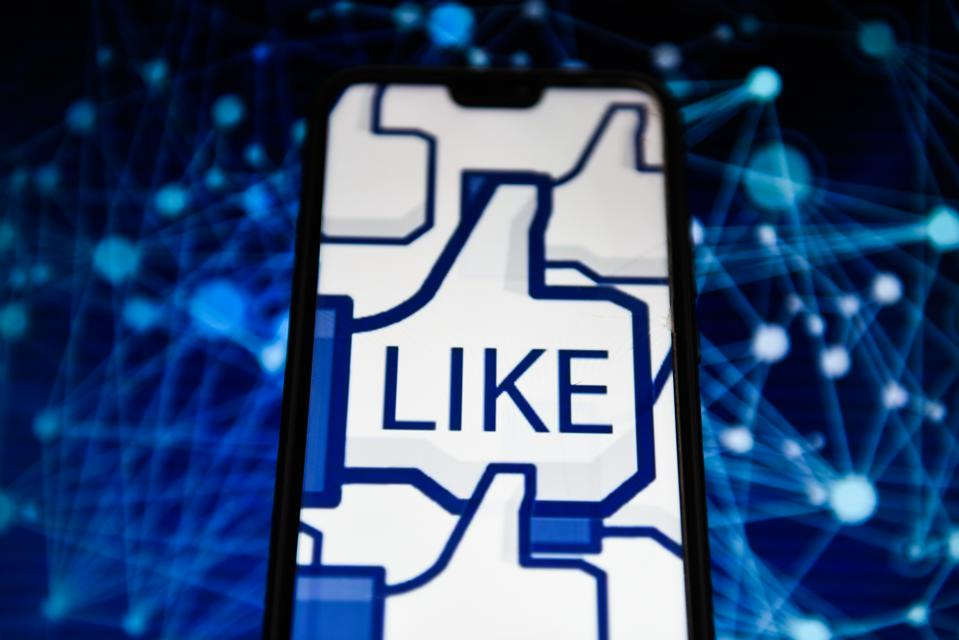 Facebook like logo is seen on an android mobile phone