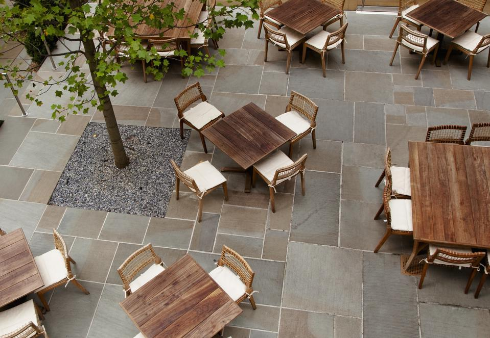 Outdoor seating and tables farther apart.
