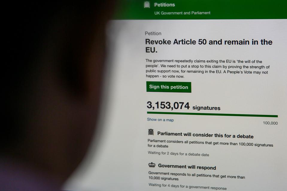 A woman in seen viewing the UK Government's Petition website...
