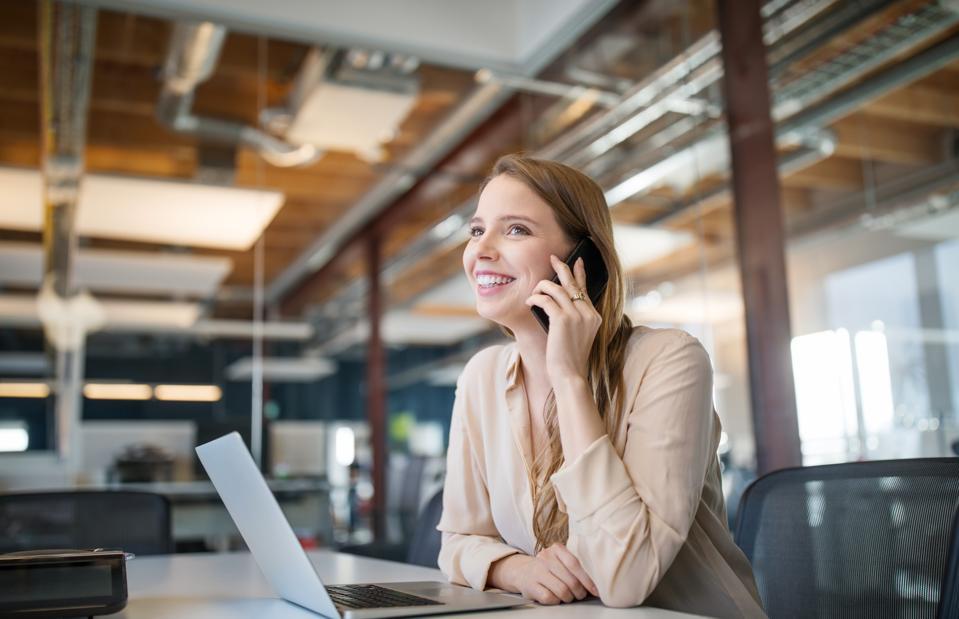 Female professional working in board room