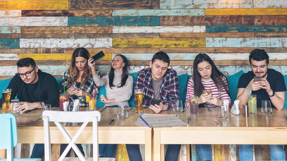 Lack of social interaction - people on phones at restaurant
