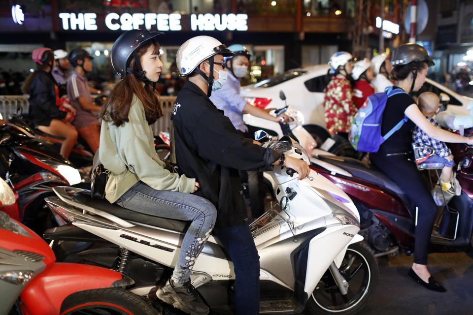 Motor Scooters on Saigon Street at night.  Ho Chi Minh City. Vietnam.
