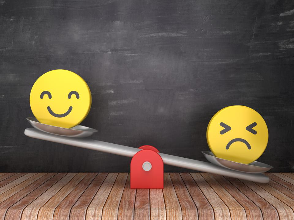 Seesaw Scale with Emoticons on Chalkboard Background - Happy up, Sad down