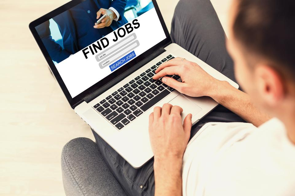 Man looks online to find a new job during Coronavirus