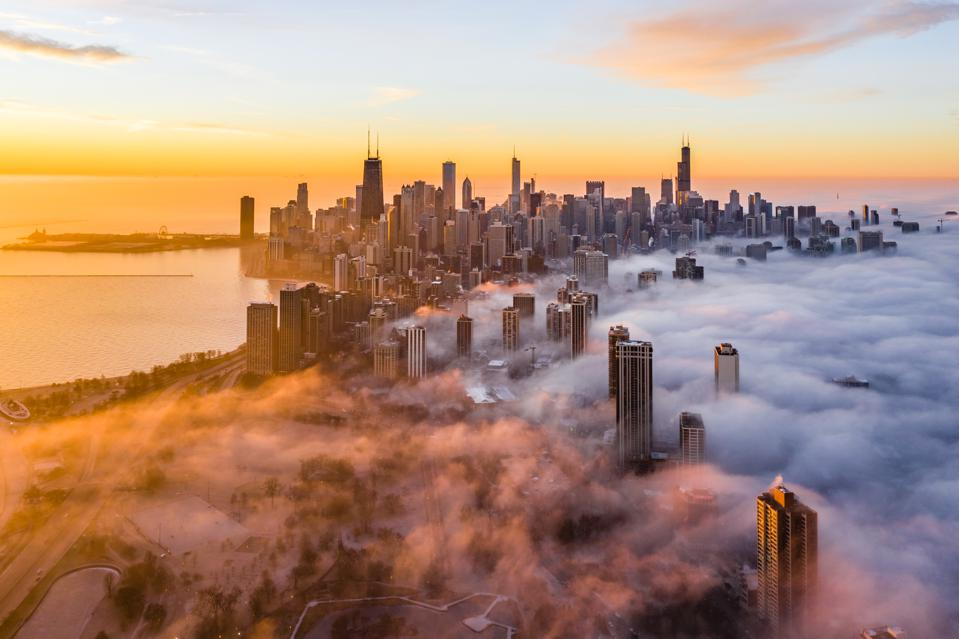 Aerial View Of Buildings And Lake Michigan Against Sky During Sunrise
