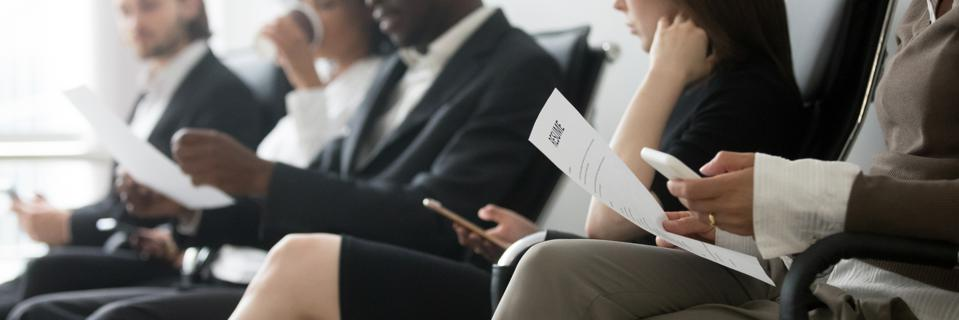 Side horizontal photo multiracial people sitting in queue waiting interview
