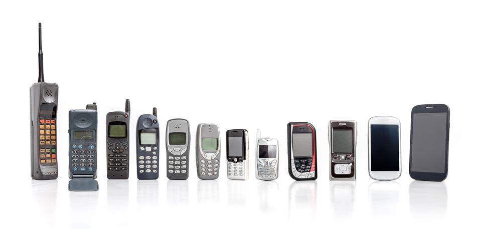 Old Mobile Phone from past to present on white background.