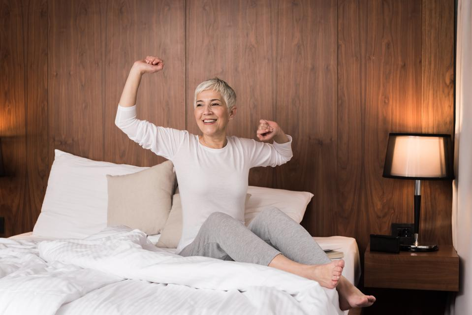 Woman stretching in her bed