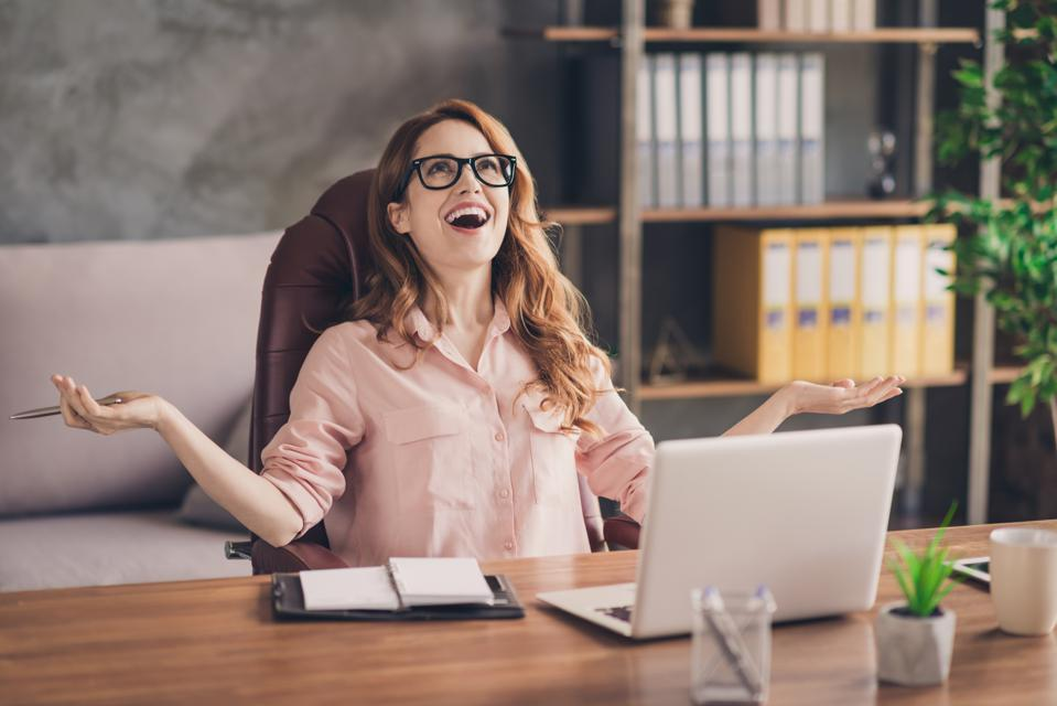 Close up photo beautiful she her business lady hand arm head raised up laugh laughter big salary income earnings genius startup notebook table sit office chair wearing specs formal-wear shirt