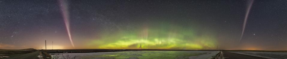 A panorama from west left to southeast right of an aurora display