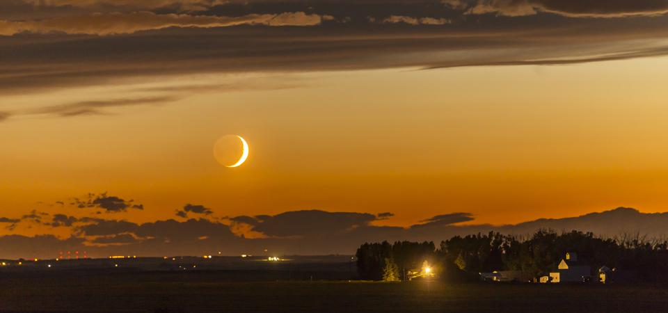 This is akin to what the Moon will look like on Friday, April 24, 2020, The dark side of the Moon is lit by Earthshine, prominent despite the Moon's low altitude and bright twilight sky. (Photo by: VW Pics/Universal Images Group via Getty Images)