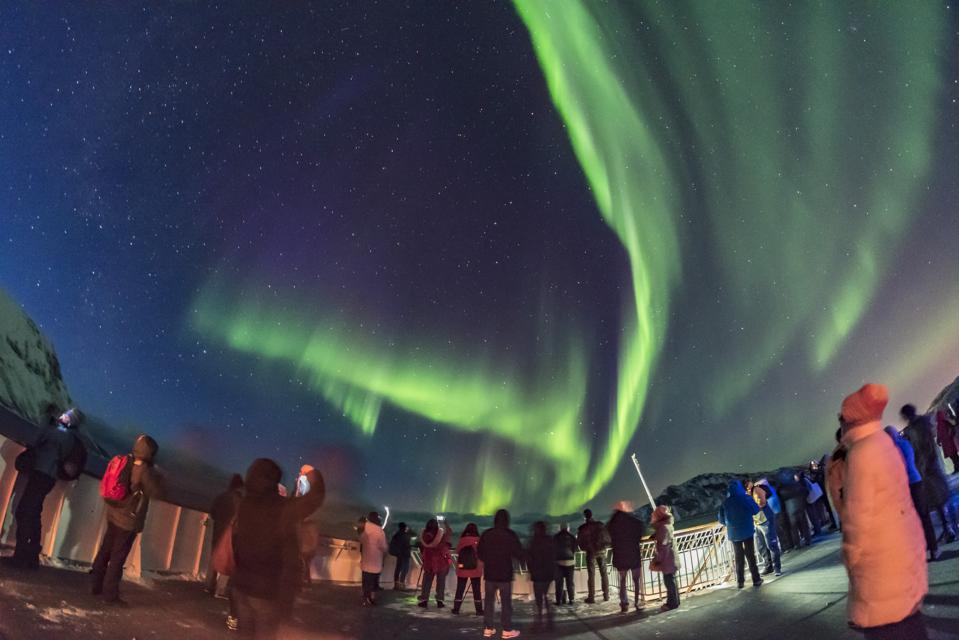 Aurora tourists taking in the sky show on March 14