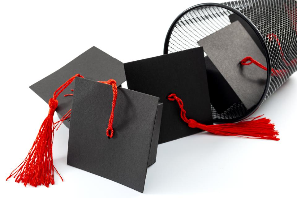Mortar boards in a trash can