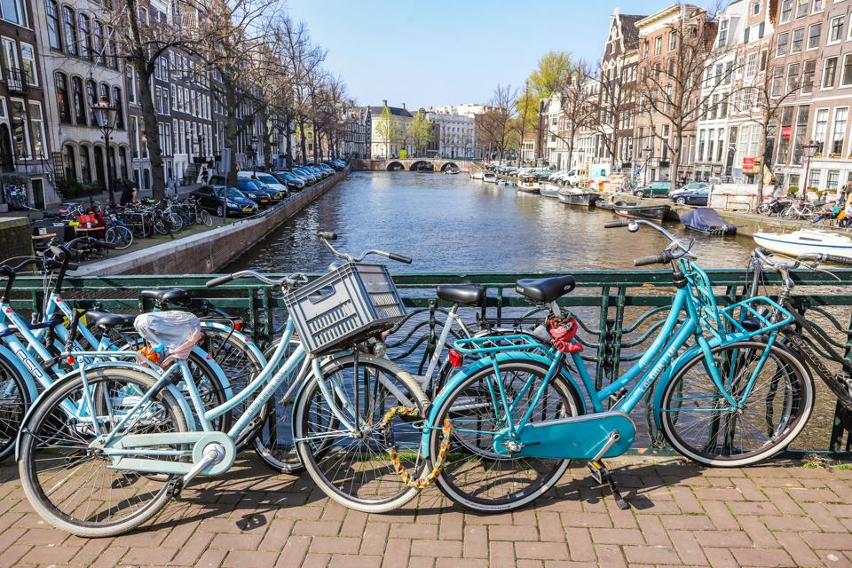 Bicycles On The Bridge Over Amsterdam Canals