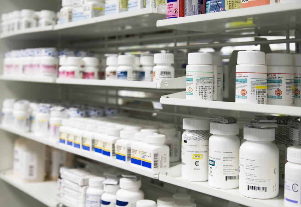 Pharmacy shelves stocked with medications