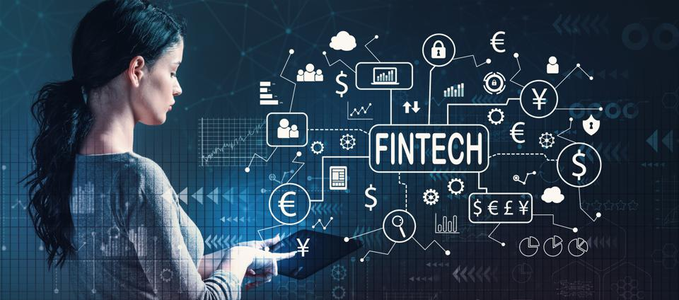 Fintech theme with woman using a tablet