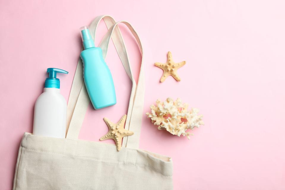 beach eco bag, plastic bottles with sunscreen