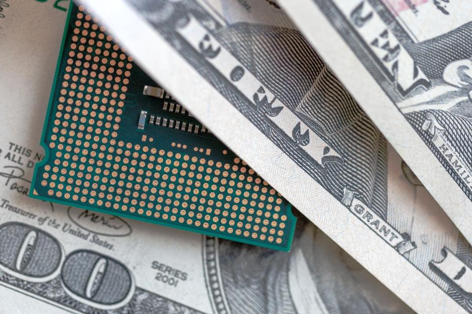 desktop cpu on dollars currency background. concept of technology price.