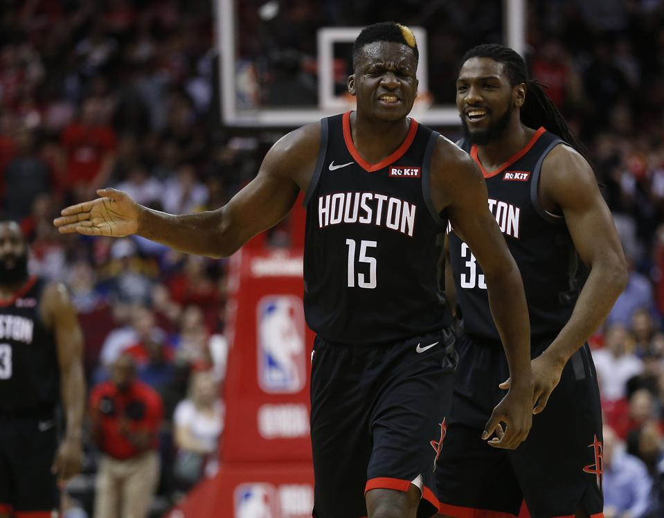 The Houston Rockets' Clint Capela with Kenneth Faried on March 13.
