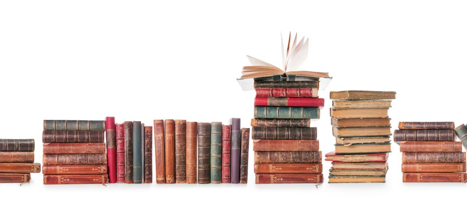 Old books row isolated on white with clipping path