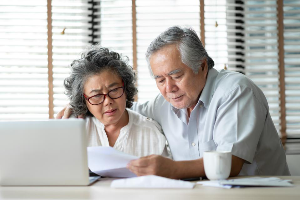 Senior Couple calculate their monthly expense.