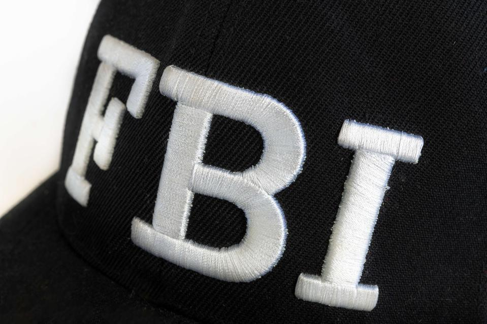 Close up of the FBI logo on a black cap