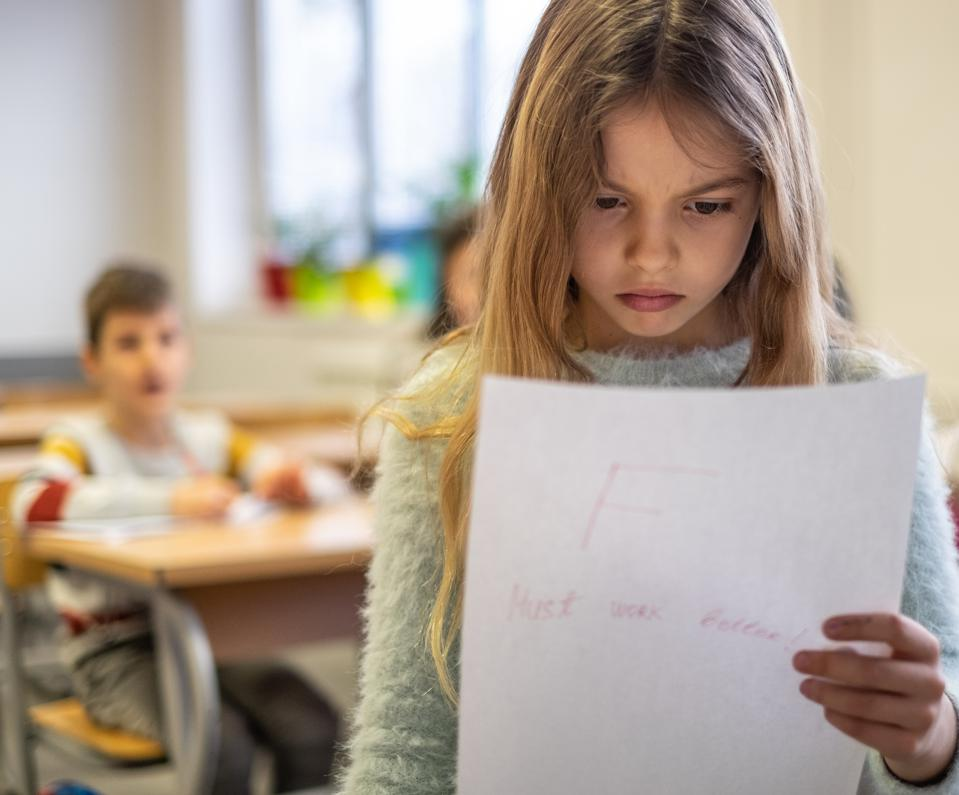 Beautiful schoolgirl is sad because bad grade