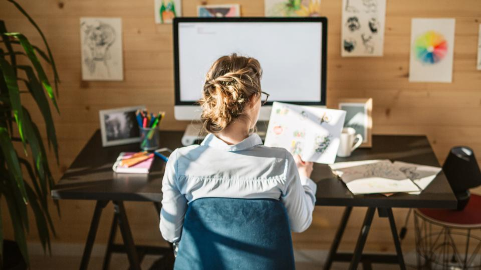 Female Graphic Designer Working In Creative Office Studio