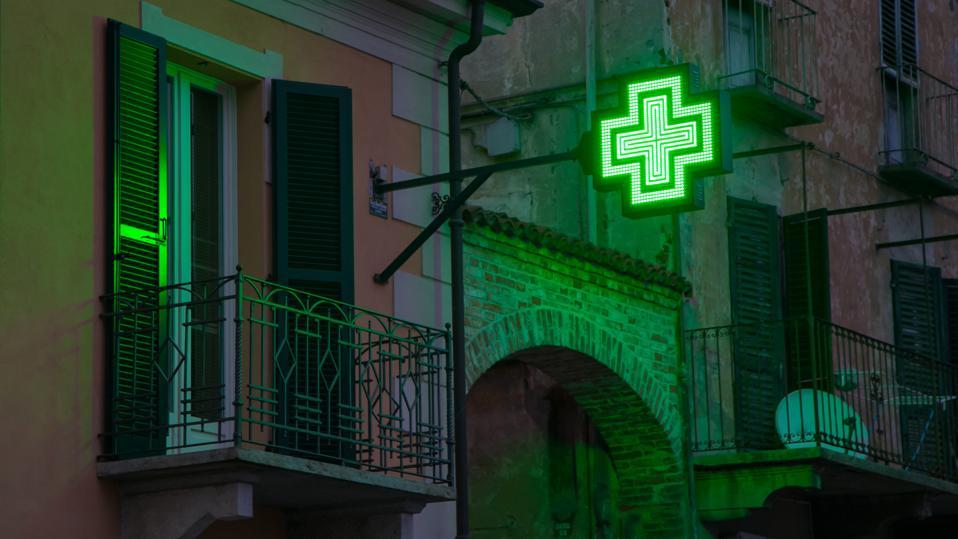 Glowing Green Pharmacy Sign
