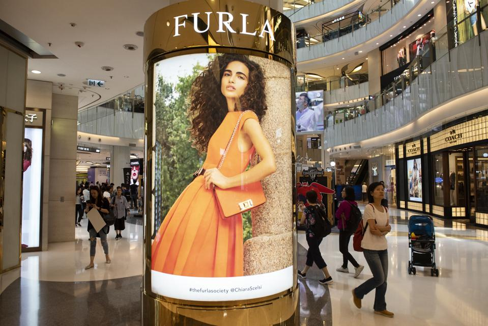 Italian clothing luxury brand Furla advertisement is seen at...