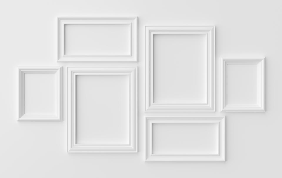 White photoframes on white wall with shadows