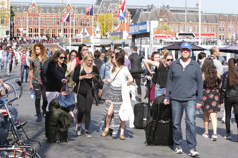 A street in Amsterdam full of tourists
