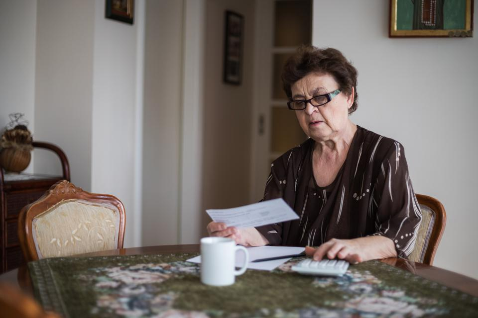 Concerned Senior Woman Reviewing Domestic Finances.